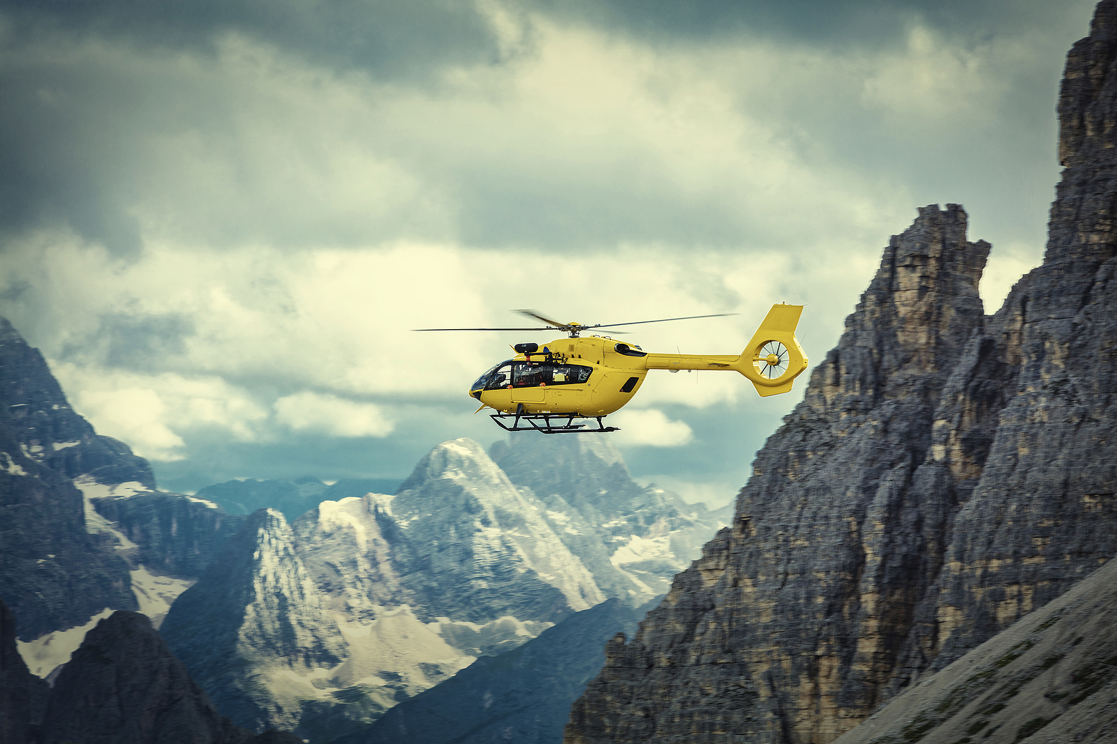 Panoramic Flight Over The Mountains. Air Transport. Helicopter F